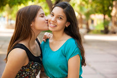Kissing my best friend Stock Images