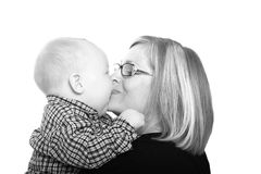 Kissing my mommy. Mommy getting a kiss from her baby boy Stock Photo