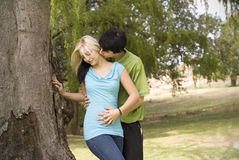 Kissing neck nest to garden tree Stock Photo