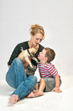 Kissing the new Family pet Pug. Cute little boy kissing his new pet Pug Royalty Free Stock Photos