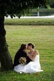 Kissing newklywed couple Stock Photos