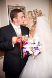 Kissing newly married couple Stock Photo