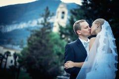 Kissing newlyweds Stock Photo