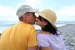 Kissing pair on beach Royalty Free Stock Images