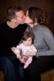 Kissing parents Stock Image
