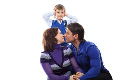 Kissing parents Stock Images