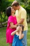 Kissing parents Stock Photos