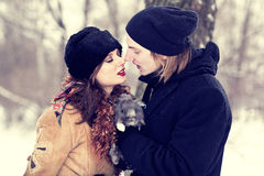 Kissing in park. Witn a gray rabbit stock photo