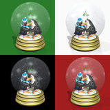 Kissing Penguins Snowglobes. Penguins kissing and holding flippers under mistletoe in a snow globe Royalty Free Stock Photo