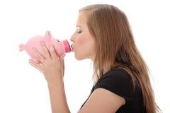 Kissing a piggy bank Stock Photos