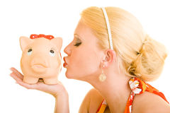Kissing a piggy bank Royalty Free Stock Photo