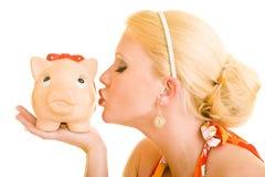 Kissing a piggy bank Royalty Free Stock Photo