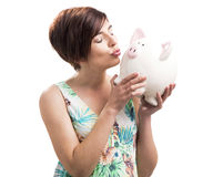 Kissing a piggy bank Royalty Free Stock Image