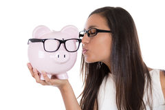 Kissing a piggy bank Stock Photo