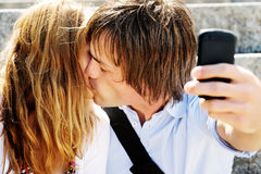 Kissing portrait phone Stock Photos