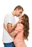 Kissing pregnant couple Royalty Free Stock Images