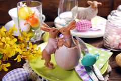 Kissing rabbits decoration on easter table Stock Photos