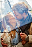 Kissing in the rain Royalty Free Stock Photos