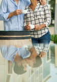 Kissing in reflection. Vertical image of a young kissing couple reflected in a mirror royalty free stock photos