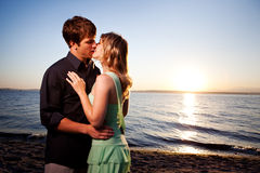 Kissing romantic couple Stock Images