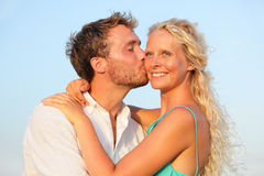 Kissing romantic couple in love smiling happy Stock Photography