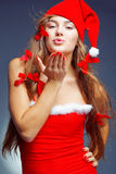 Kissing santa helper girl Royalty Free Stock Photo