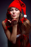 Kissing santa helper girl Stock Photo