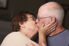 Kissing Senior Couple Stock Photography