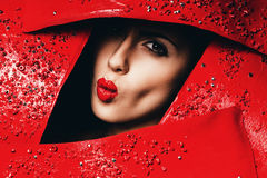Kissing sexy woman in red frame Stock Images