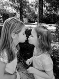 Kissing Sisters. Sister, love, kiss, sweet, black and white, adorable, friends, babies , precious, little girls, sissy, nice Stock Photos