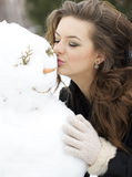 Kissing the snowman Royalty Free Stock Images