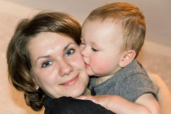 Kissing son with mother Stock Image
