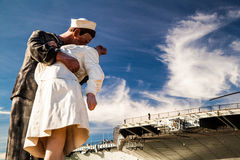 Kissing statue andUSS Midway Aircraft carrier. Attraction in San Diego - USS Midway Aircraft carrier stock images