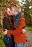 Kissing in the sunny autumn Stock Photos