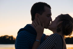 Kissing at sunset Royalty Free Stock Photography