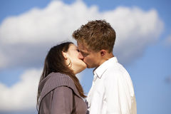 Kissing teenage lovers Royalty Free Stock Image