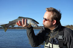 Kissing the trout royalty free stock images