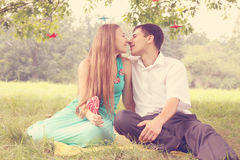 Kissing under a tree Stock Photos