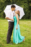 Kissing under umbrella Royalty Free Stock Photography