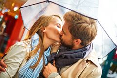 Kissing under umbrella Stock Photography