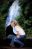 Kissing by the Waterfall Stock Image