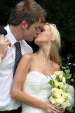 Kissing Wedding Couple Stock Photo