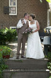 Kissing wedding couple Royalty Free Stock Image