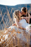 Kissing wedding couple Royalty Free Stock Photo