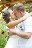 Kissing wedding couple. Portrait of romantic couple touching and kissing each other Stock Images
