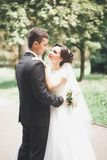 Kissing wedding couple in spring nature close-up portrait.  Stock Photo