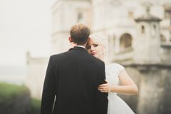 Kissing wedding couple in spring nature close-up portrait Royalty Free Stock Photos