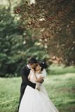 Kissing wedding couple in spring nature close-up portrait.  Royalty Free Stock Photo
