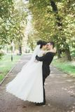 Kissing wedding couple in spring nature close-up portrait.  Royalty Free Stock Photography