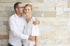 Kissing wife Royalty Free Stock Photos